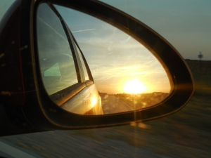 With the setting sun in the rearview mirror, we head east.