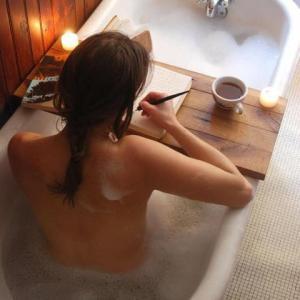 writer in tub -