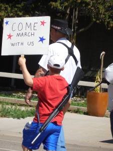 My photo of the young boy and his weapon chills me. This is my home? I don't think so.
