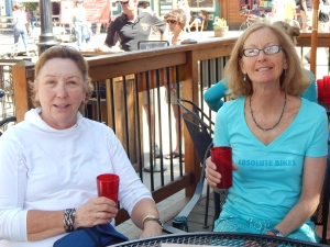 Deb Davies and Lori Fox raise a glass to tomorrow's ride.